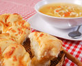 Cheesy Bread and Chicken Soup Stock Photo