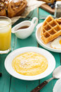Cheesy grits for breakfast with butter in a white bowl Royalty Free Stock Photos