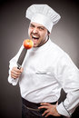 Chef with apple on knife Royalty Free Stock Photo