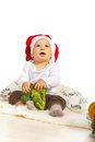 Chef baby looking up holding broccoli and to copy space Stock Image
