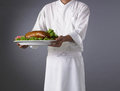 Chef background with peking duck food on black Royalty Free Stock Image