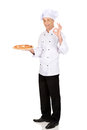 Chef baker with italian pizza showing perfect sign Royalty Free Stock Photo