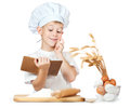 Chef boy is reading a recipe cook Stock Photo