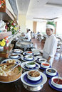 Chef at buffet restaurant Royalty Free Stock Photo