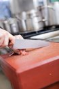 Chef or butcher dicing meat Royalty Free Stock Photo