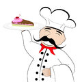 Chef with a cake on a plate Royalty Free Stock Photography