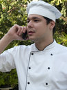 Chef on cellular phone Royalty Free Stock Photos