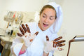 Chef with chocolate on gloved hands