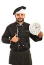 Chef with clock giving thumb up man holding a big and isolated on white background Stock Images