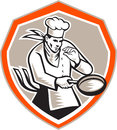 Chef cook holding frying pan retro illustration of a set inside shield on background done in woodcut style Royalty Free Stock Image