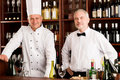 Chef cook and waiter restaurant wine bar Royalty Free Stock Image