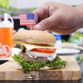 Chef cooking and decorated hamburger with american flag concept Stock Photography
