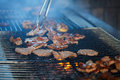 Chef cooking meat close up of on grill Royalty Free Stock Images