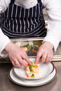 Chef cooking seafood lasagna Royalty Free Stock Photography