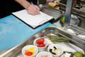 Chef is creating new dish Stock Photography
