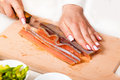 Chef cuts the fillet of red fish closeup Royalty Free Stock Photo