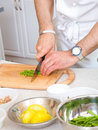Chef cutting the beans Royalty Free Stock Image