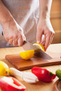 Chef cutting lemon s hands fresh Stock Photo