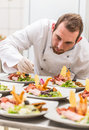 stock image of  Chef decorating appetizer plate