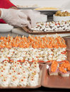 Chef garnishing canapes for party Royalty Free Stock Photography