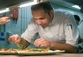 Chef Garnishing Food in Kitchen Royalty Free Stock Photo