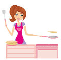 Chef girl fries pancakes on Shrovetide Stock Image