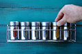 Chef hand returning spice into a spice rack Royalty Free Stock Photo