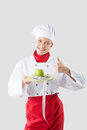 Chef hands holding an apple a green Royalty Free Stock Photo