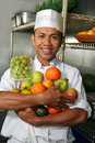 image photo : Chef holding fruits