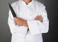 Chef holding knife closeup of a with his arms folded a Royalty Free Stock Image