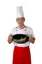 Chef holding raw fish on a frying pan Royalty Free Stock Images