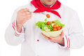 Chef holding salad wearing red and white uniform over white background Stock Photos