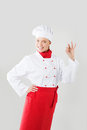 Chef inviting at restaurant on a neutral background Royalty Free Stock Photo