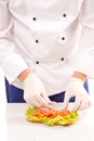 Chef making sandwiches on white background Royalty Free Stock Images