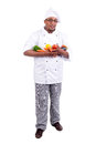 Chef male with fruits and vegetables isolated in white Royalty Free Stock Image