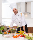 Chef male portrait on white countertop at kitchen with food Royalty Free Stock Images