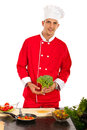 Chef man holding brocolli mman in kitchen preparing food and Royalty Free Stock Photo