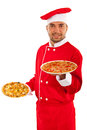 Chef man holding pizza two on plates isolated on white background Stock Photo