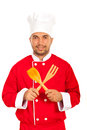 Chef man with wooden utensils Royalty Free Stock Photo