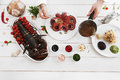 Chef pouring octopus with special sauce, flat lay Royalty Free Stock Photo