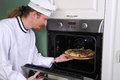 Chef prepared italian pizza in kitchen Stock Photos