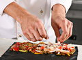 Chef preparing pasta roll Stock Image
