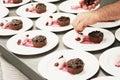 Chef preparing plated desserts chocolate tart Royalty Free Stock Photos