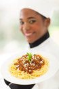 Chef presenting spaghetti young delicious dish Royalty Free Stock Photos
