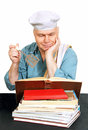 Chef with recipe book cook man looking for a in the cook white background Royalty Free Stock Photos