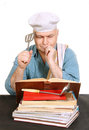 Chef with recipe book cook man looking for a in the cook white background Royalty Free Stock Photography