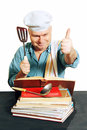 Chef with recipe book cook man looking for a in the cook white background Royalty Free Stock Images