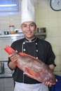 Chef and red snapper fish Stock Photo