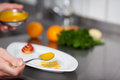 Chef s hands garnishing plate on kitchen counter closeup of commercial Stock Images