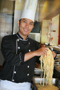 Chef showing spaghetti Royalty Free Stock Image